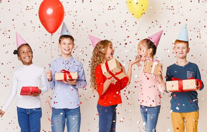 Kids celebrating birthday party together over background