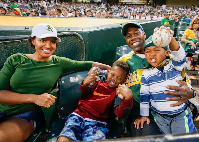 Family enjoying Oakland A's game