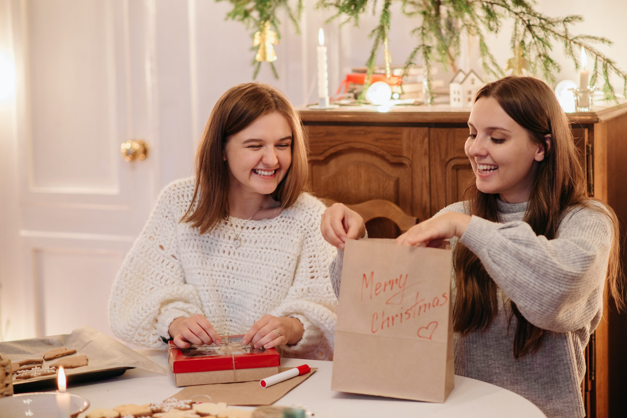 Friends doing some last-minute gift wrapping