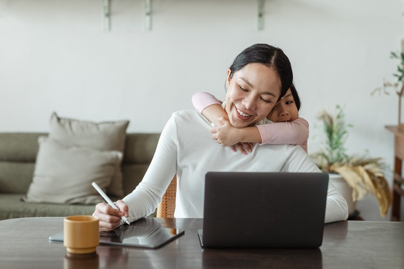 Mom working from home with daughter